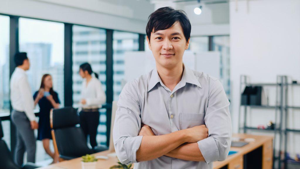 Portrait of successful handsome executive businessman smart casu